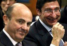 De Guindos y Goirgolzarri celebraron los rescates bancarios, aunque aún tendrán que soportar muchos 'palos en las ruedas' en el camino de la depuración de Bankia.
